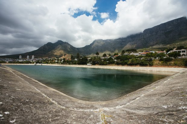 Water Sits In The Molteno Reservoir As Table Mountain Stands Beyond In Cape Town, South Africa On Monday, Nov. 13, 2017. Cape Town Has Tightened Water Usage Restrictions, Banning The Use Of Potable Water To Irrigate Gardens, Wash Cars Or Top Up Swimming Pools, As It Confronts Its Worst Drought On Record And A Delay To The Onset Of The Winter Rainy Season. Photographer: Waldo Swiegers/Bloomberg Via Getty Images