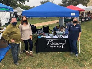 Three volunteers with Blanco County Friends of the Night Sky at Market Day in Blanco