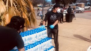 Volunteers hand out bottled water