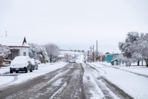 Marfa is covered with snow on Thursday, Feb. 18, 2021. Like other parts of Texas, rural communities were hammered by the winter storm that left families without the basic necessities of heat and running water. But temperatures in the country dipped lower than in cities, plummeting to the low single digits. Credit: Sarah M. Vasquez for The Texas Tribune