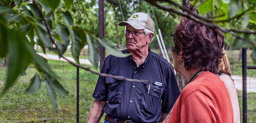 Mark Friesenhahn Stands Outside Under A Pecan Tree
