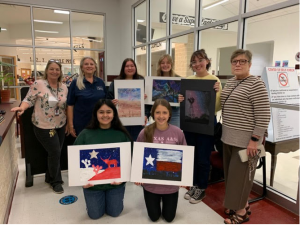 Displaying the prize-winning artwork at Johnson City High School are: Kneeling (l to r): Marlen Torres (1st place), Bree Herrera (5th place); Standing (l to r) Diane Hudson (Art Teacher), Vicki Guidry (BCFNS), Trinity Rendon (Honorable Mention), Neely Burrier (4th place), Ava Hermes (3rd place), and Barbara Hudson (BCFNS)