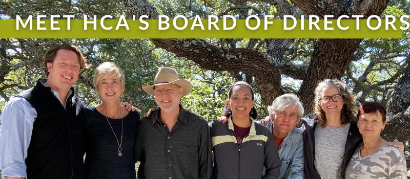 HCA board members smile in front of an oak tree