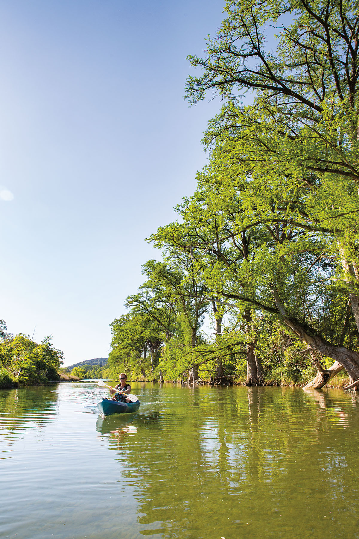WIMBERLEY, TX - MAY 6, 2021 - Author Joe Nick Patoski Paddles The Blanco River Near His Home.