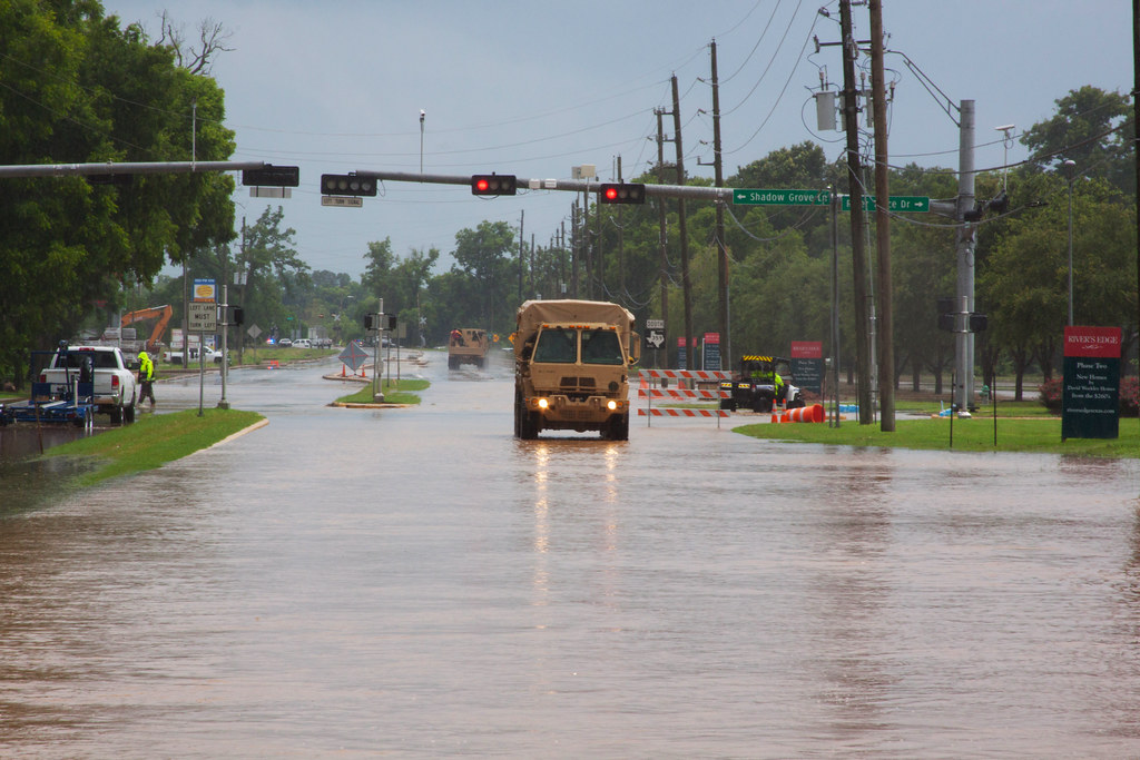 Vehicle Driving Through Flooded Road