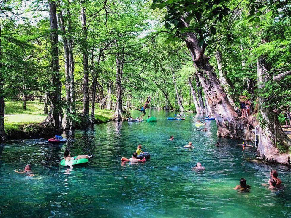 Peope Swimming In The River At Blue Hole Regional Park
