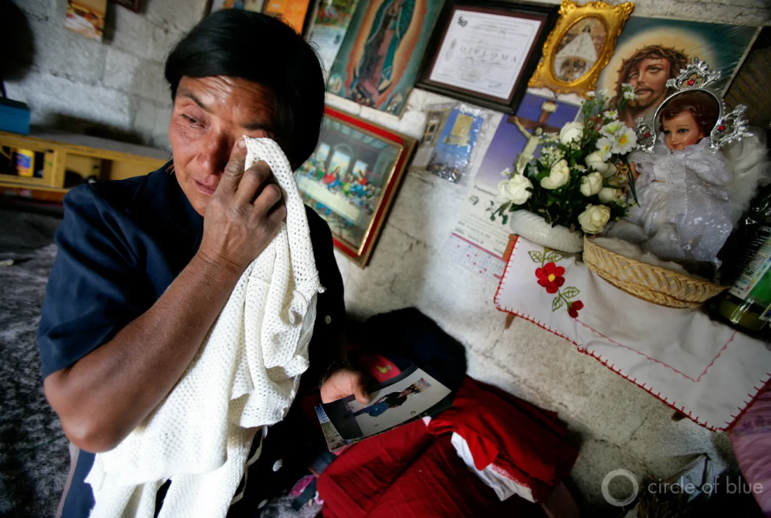 A Mother Wipes Away A Tear While Looking At Photos Of Her Son How Moved Away For Work