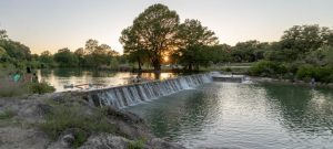 Photo of short river dam at Blanco State Park
