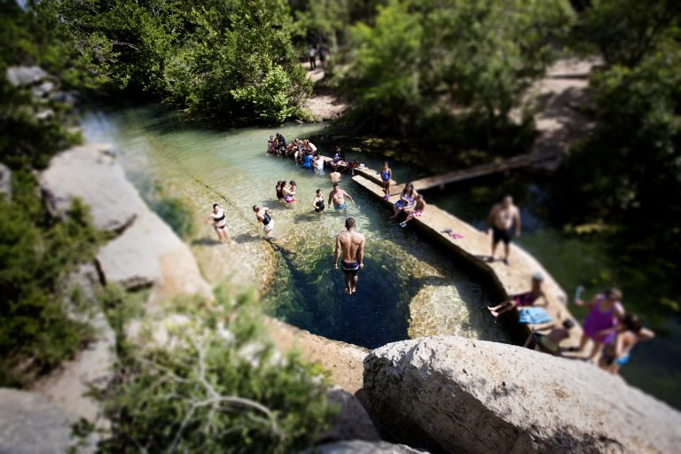 A Group Of People Swimming In Jacob's Well