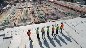 A group of construction workers looking over a construction zon